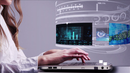 Woman using laptop with business hologram interface Footage