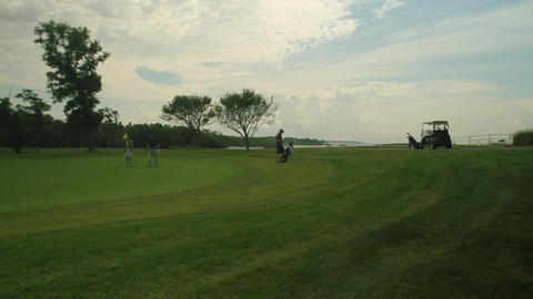 Golfers leaving the green (1 of 2) Footage