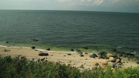 View of rocky/sandy coastline (1 of 2) Footage