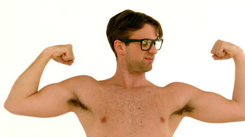 In slow motion geeky hipster showing his muscles Live Action