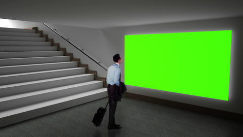 Businessman looking at green screen Animation