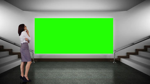 Businesswoman looking at green screen Animation
