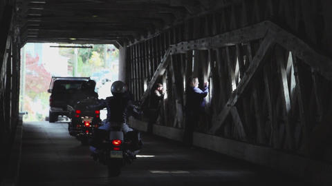 Cars and pedestrians entering covered bridge (3 of 4) Footage