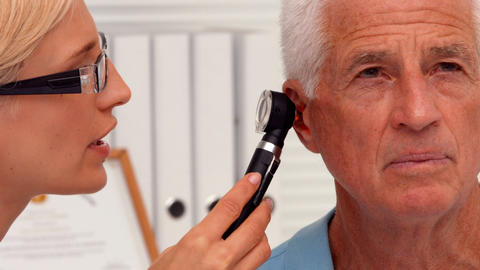 Doctor examining her patients ears Footage