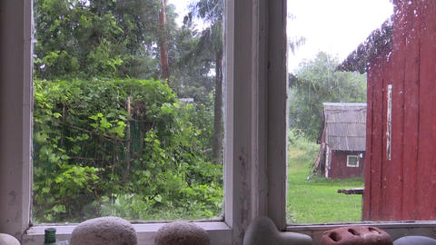 Rainy day shot from rural homestead window Footage