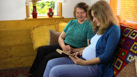 Happy family women have fun reading book Footage