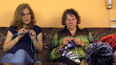 Old grandma and young woman knit and balls of wool thread Footage