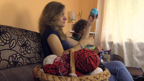 Basket wool balls and woman roll blue ball. grandma knit socks Footage
