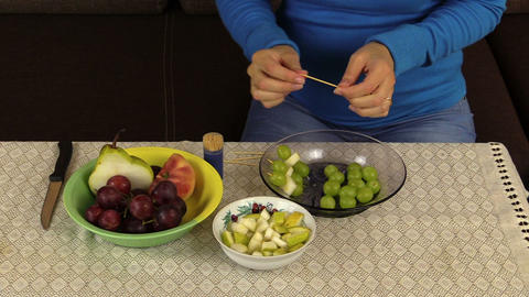 hand make snack grape and pears on wooden stick fruit vase table Footage