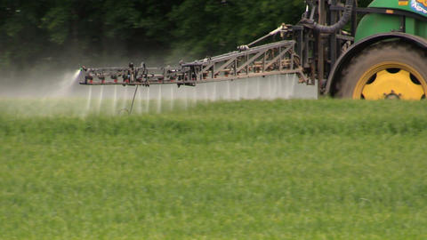 Spraying crops field with tractor and sprayer, farming, harvest Footage