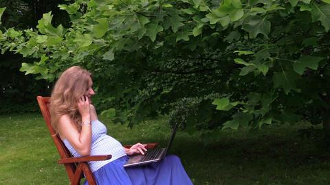 blonde pregnant girl talk phone break from laptop chatting park Footage
