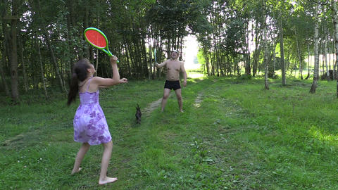 Happy father with daughter play badminton game Footage