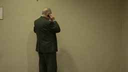 Back view of businessman on cell phone (1 of 2) Live Action