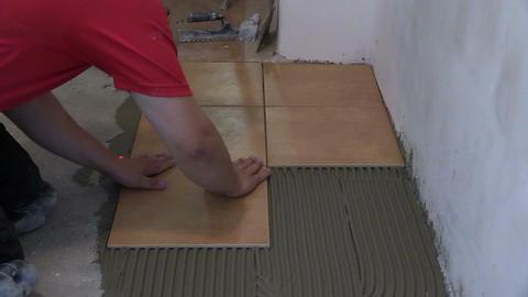 Home improvement, renovation - handyman lay tile on room floor Footage