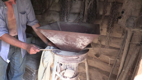 Farmer Grind Grain With Special Equipment In Farm Mill stock footage