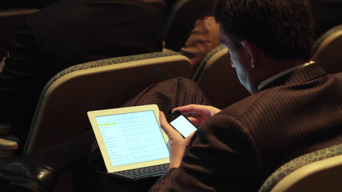 Using a mobile device at a meeting (1 of 5) Footage