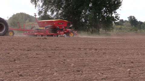 Tractor working in field. Time of sowing. Planting crops Footage