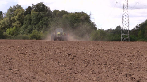 machine spread fertilizer on cultivated field soil Footage