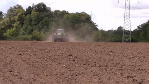 machine spread fertilizer on cultivated field soil Footage