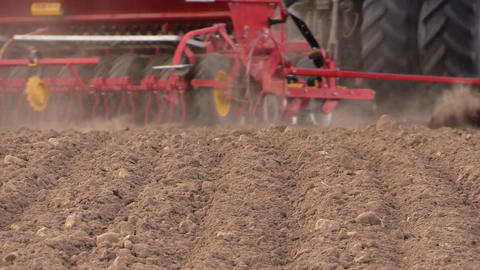 Soil and tractor fertilizing field. Heavy agricultural machinery Footage