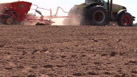 Tractor working in field. Time of sow. Planting crops Footage