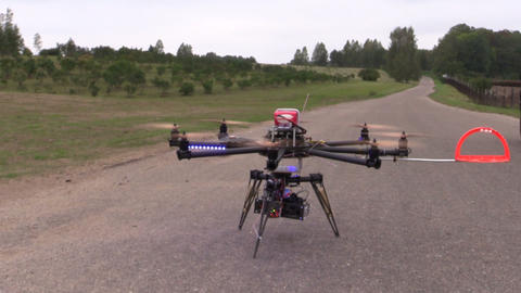 Octocopter Copter With Camera Start And Fly In Air stock footage