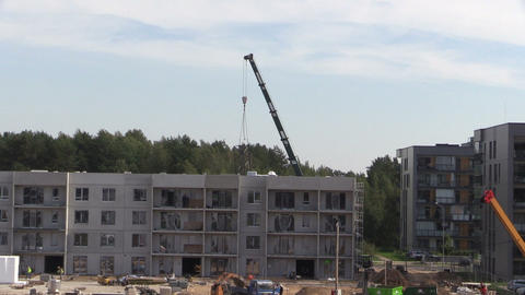 Intensive construction site works. Workers and cranes Footage