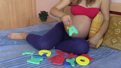 future mom nude belly and hand stick baby letters. Expect baby Footage
