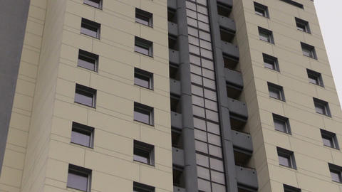 zoom out of renovated high flat apartment house windows Footage
