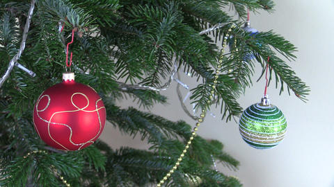 Christmas tree ball toys and decorations and blink white garland Footage