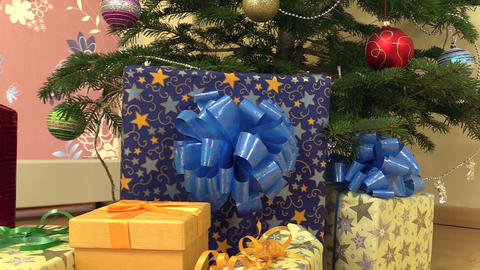 colorful gift present boxes with ribbon under christmas fir tree Footage