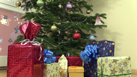 colorful gift present boxes with ribbon under christmas tree Footage