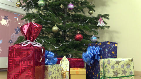 Decorated christmas fir tree and colorful gifts presents boxes Footage