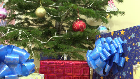 colorful gifts presents boxes under christmas tree with toys Footage