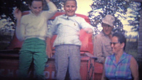 ARKANSAS, USA - 1965: Family hanging out around the classic Chevy truck Footage
