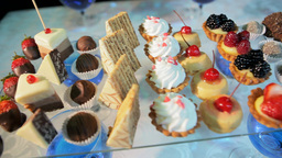 A Variety Of Pastries On A Glass Stand stock footage