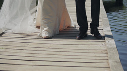Wedding Couple - View From The Bottom , Legs, Go Over The Bridge stock footage