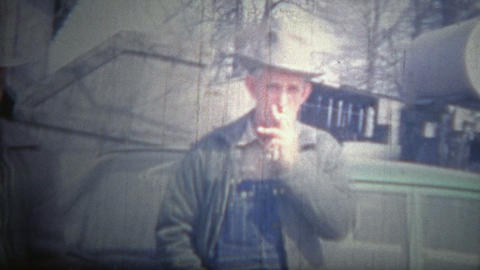 ARKANSAS, USA - 1966: Farmer brothers wearing fedora hats and overalls as the un Footage