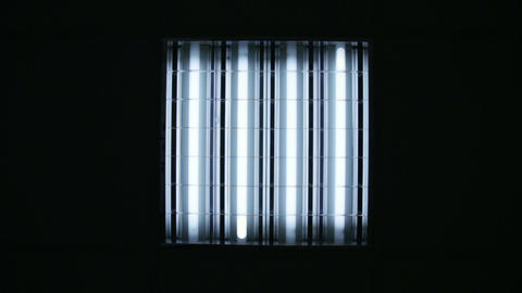 Bank of fluorescent lights turning on and off Footage