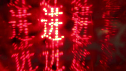 Rotating LED Chinese characters wishing prosperity Footage