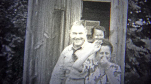 OKLAHOMA, USA - 1943: People Comedically Leaving A Stinky Outhouse stock footage