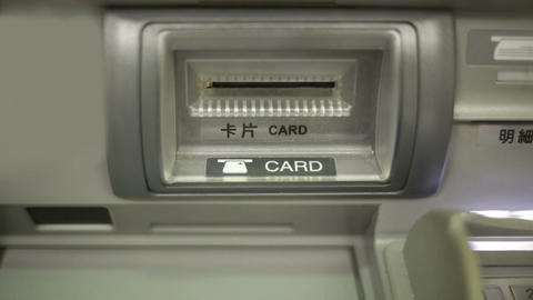 Inserting ATM card in slot -shot from front Stock Video Footage