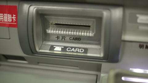 Inserting Bankcard At ATM With Traditional Chinese Instructions stock footage