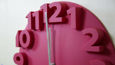 Red clock with time approaching midnight Footage