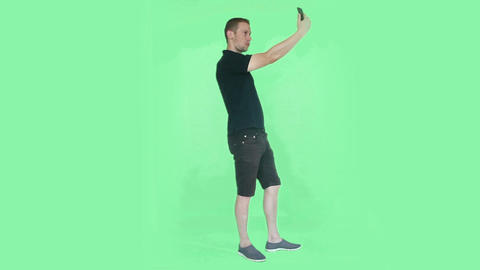 young man taking selfie green screen Footage