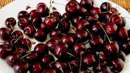 Plate With Very Ripe cherries, emptying.Stop Motion, Zoom Out Footage