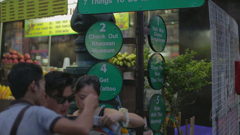 tourists looking at man - khaosan road Footage