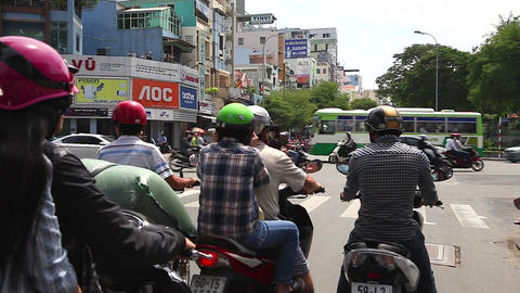 wide pan -vietnamese scooters at traffic light Footage