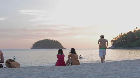 golden sunset - karon beach Phuket - Asian women and Asian man Live Action