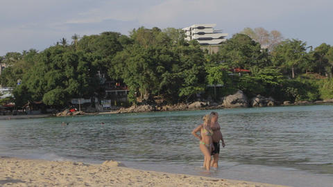 middle aged caucasion couple walk at Phuket beach in the morning Footage